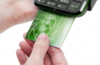 An EMV compliant POS processes a transaction with a chip card.