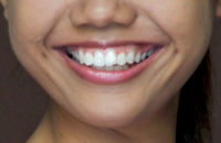 A close up of a girl smiling